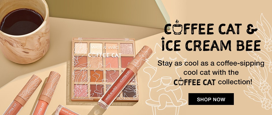 wet n wild | Coffee Cat and Ice Cream Bee Stay as cool as a coffee-sipping cool cat with the Coffee Cat Collection | A coffee cup, eyeshadow palette, and three lip glosses laying on a beige background | SHOP NOW