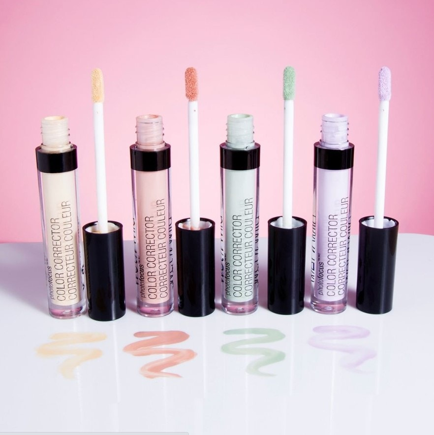 color correcting concealers in purple, yellow, green, and peach