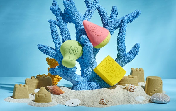 SpongeBob, Patrick and Squidward Makeup Sponges | wet n wild | Products angled on blue coral, with sand and blue background